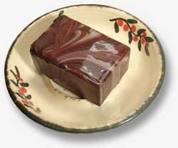 Soap on stoneware soap dish.